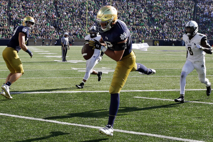 1cf3491f0 Notre Dame tight end Nic Weishar (82) catches a touchdown pass against  Vanderbilt during the second half of an NCAA college football game in South  Bend