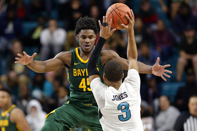 Baylor guard Davion Mitchell (45) guards Coastal Carolina guard Devante Jones (3) during the second half of an NCAA college basketball game at the Myrtle Beach Invitational in Conway, S.C., Friday, Nov. 22, 2019. (AP Photo/Gerry Broome)