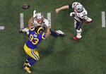 New England Patriots' Tom Brady (12) throws the ball as Los Angeles Rams' Ndamukong Suh (93) rushes during the second half of the NFL Super Bowl 53 football game Sunday, Feb. 3, 2019, in Atlanta. (AP Photo/Morry Gash)