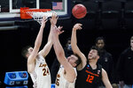 Oregon State center Roman Silva (12) fights for a rebound with Loyola Chicago guard Tate Hall (24) and center Cameron Krutwig, center, during the first half of a Sweet 16 game in the NCAA men's college basketball tournament at Bankers Life Fieldhouse, Saturday, March 27, 2021, in Indianapolis. (AP Photo/Jeff Roberson)