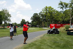 Bubba Watson hits onto the 17th green drives during a nine-hole exhibition ahead of the Rocket Mortgage Classic golf tournament, Wednesday, July 1, 2020, at the Detroit Golf Club in Detroit. (AP Photo/Carlos Osorio)