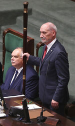 Speaker Senior Antoni Macierewicz opens the gala session of Poland's new parliament by knocking with an ornamented wooden staff on the floor three times, in Warsaw, Poland, Tuesday, Nov. 12, 2019. (AP Photo/Czarek Sokolowski)