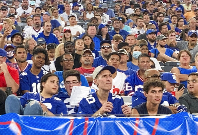Fans attend the New York Giants' NFL football practice at MetLife Stadium on Wednesday, Aug. 11, 2021, in East Rutherford, N.J. (AP Photo/Tom Canavan)