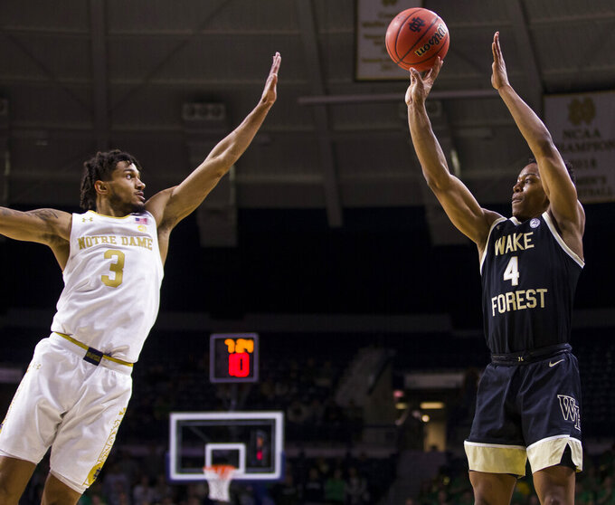Wake Forest's Jahcobi Neath (4) shoots a 3-pointer over Notre Dame's Prentiss Hubb (3) during the first half of an NCAA college basketball game Wednesday, Jan. 29, 2020, in South Bend, Ind. (AP Photo/Robert Franklin)