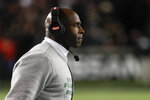 South Florida head coach Charlie Strong works the sidelines during the first half of an NCAA college football game against Cincinnati, Saturday, Nov. 10, 2018, in Cincinnati. (AP Photo/John Minchillo)
