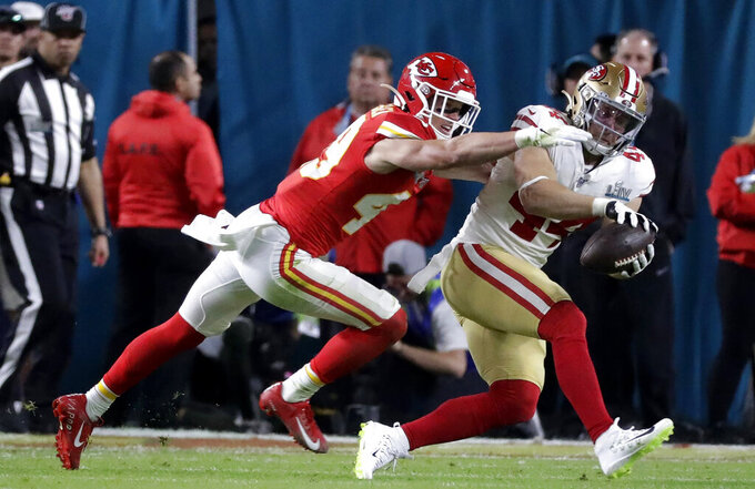 San Francisco 49ers' Kyle Juszczyk (44) catches a pass in front of Kansas City Chiefs' Daniel Sorensen before scoring during the first half of the NFL Super Bowl 54 football game Sunday, Feb. 2, 2020, in Miami Gardens, Fla. (AP Photo/Wilfredo Lee)