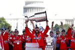 FILE - In this June 12, 2018, file photo, Washington Capitals Alex Ovechkin, from Russia, holds up the Stanley Cup trophy during the NHL hockey team's Stanley Cup victory celebration at the National Mall in Washington. Washington was so bad for so long in the major professional sports but maybe soon it will be said that D.C. stands for District of Champions. The Nationals are in the city's first World Series in 86 years. The Mystics recently won the WNBA championship. And the Capitals won the Stanley Cup in 2018. Before that, the nation's capital endured a 26-year championship drought across MLB, NFL, NBA and NHL. (AP Photo/Jacquelyn Martin, File)