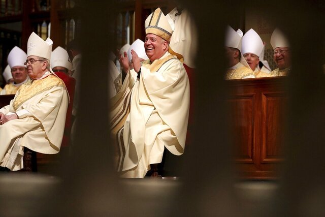 Archbishop Nelson J. Pérez, center, reacts during his installation at the Cathedral Basilica of Saints Peter and Paul in Philadelphia on Tuesday, February 18, 2020. Pérez, who is the 10th archbishop of Philadelphia, is the first Latino archbishop in Philadelphia. (David Maialetti/The Philadelphia Inquirer via AP, Pool)