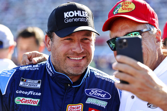 NASCAR Cup Series driver Ryan Newman smiles for a photo with a fan before a NASCAR Cup Series auto race at Charlotte Motor Speedway in Concord, N.C., Sunday, May 30, 2021. (AP Photo/Nell Redmond)