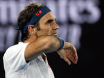 Switzerland's Roger Federer wipes the sweat from his face during his third round match against United States' Taylor Fritz at the Australian Open tennis championships in Melbourne, Australia, Friday, Jan. 18, 2019. (AP Photo/Kin Cheung)