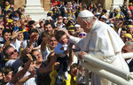 Pope Francis caresses a child as he leaves the Basilica of Our Lady of Loreto where he celebrated mass and prayed in the shrine containing a small house traditionally venerated as the house of Mary, and believed miraculously transplanted from the Holy Land inside the Basilica, in central Italy, during a one-day visit, Monday, March 25, 2019. The pope chose Loreto to sign the Post-Synodal Exhortation of last October's Synod of Bishops. (AP Photo/Domenico Stinellis)