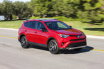 This undated photo provided by Toyota shows the 2016 Toyota RAV4. Some notable features in higher trims of the vehicle are an auto-dimming rearview mirror, Toyota Safety Sense package and a 360-degree top-down parking camera system. (Dewhurst Photography/Toyota Motor Sales U.S.A. via AP)