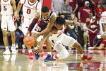 Arkansas forward Gabe Osabuohien (22) and Texas A&M guard TJ Starks (2) go after the ball during the first half an NCAA college basketball game, Saturday, Feb. 23, 2019, in Fayetteville, Ark. (AP Photo/Michael Woods)