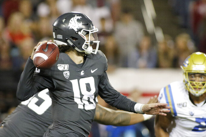 Washington State quarterback Anthony Gordon (18) prepares to pass the ball during the second half of an NCAA college football game against UCLA in Pullman, Wash., Saturday, Sept. 21, 2019. UCLA won 67-63 (AP Photo/Young Kwak)