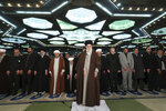 In this photo released by the official website of the office of the Iranian supreme leader, Supreme Leader Ayatollah Ali Khamenei, center, leads the Friday prayers at Imam Khomeini Grand Mosque in Tehran, Iran, Friday, Jan. 17, 2020. Iran's supreme leader said President Donald Trump is a