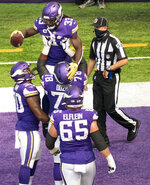 Minnesota Vikings running back Dalvin Cook (33) celebrates his first quarter touchdown run as teammate Dakota Dozier (78) lifts him up, during an NFL football game against the Green Bay Packers Sunday, Sept. 13, 2020, in Minneapolis.  (Jerry Holt/Star Tribune via AP)