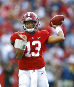 Alabama quarterback Tua Tagovailoa (13) throws a pass during the first half of an NCAA college football game against Auburn, Saturday, Nov. 24, 2018, in Tuscaloosa, Ala. (AP Photo/Butch Dill)
