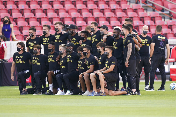 Players from Los Angeles FC pose for a group photo on the field prior to the announcement that their game against Real Salt Lake was called off Wednesday, Aug. 26, 2020, in Sandy, Utah. Major League Soccer players boycotted five games Wednesday night in a collective statement against racial injustice. The players' action came after all three NBA playoff games were called off in a protest over the police shooting of Jacob Blake in Wisconsin on Sunday night. (AP Photo/Rick Bowmer)