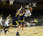 Baylor guard Devonte Bandoo, right, pulls down a rebound over West Virginia forward Andrew Gordon and forward Logan Routt, left, in the second half of an NCAA college basketball game, Saturday, Feb. 23, 2019, in Waco, Texas. Baylor won 82-75. (Ernesto Garcia/Waco Tribune-Herald via AP)