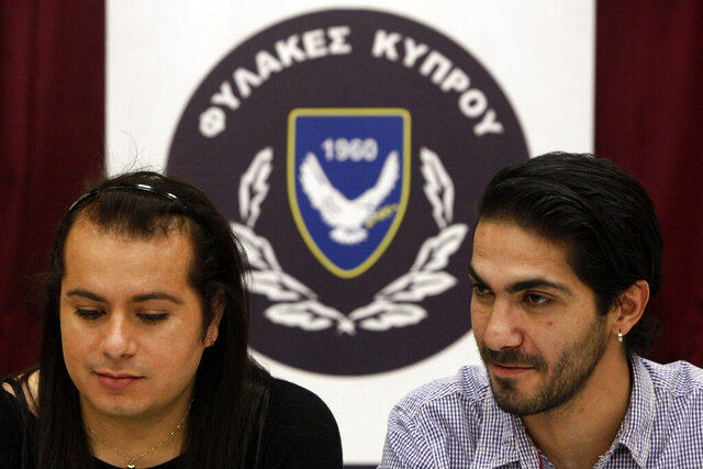 Cypriot Kevork Tontian, right, and Brazilian Wemson Gabral da Costa talk during an interview inside Cyprus' prison complex in capital Nicosia, Cyprus, Thursday, Jan. 16, 2020. Former heroin addict Kevork Tontian says he met the man he wanted to spend the rest of his life with behind bars, and not even his freedom was enough to keep him away from Wemson Gabral da Costa. (AP Photo/Petros Karadjias)