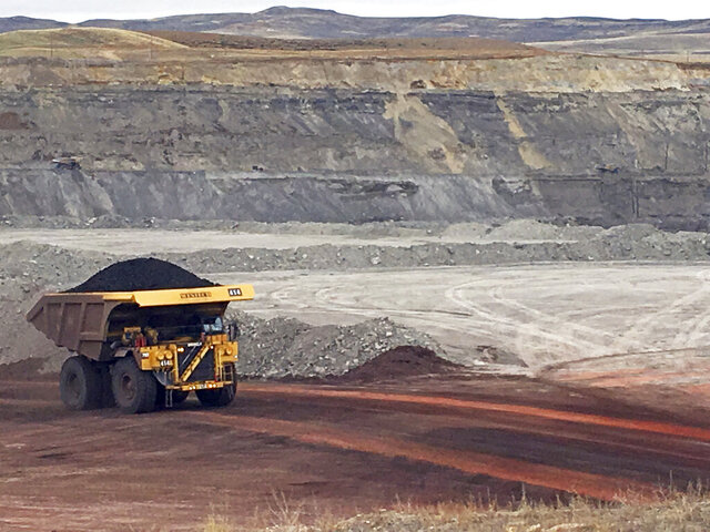FILE - In this March 28, 2017 file photo, a dump truck hauls coal at Contura Energy's Eagle Butte Mine near Gillette, Wyo. After the first round of major Powder River Basin coal layoffs and bankruptcies in 2015 and 2016, the buzzworthy response was Wyoming and Campbell County would have to adjust to a