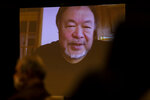 "Chinese artist and  political activist Ai Weiwei, speaking from Lisbon, Portugal, is seen on a screen during a virtual news conference at the Foreign Corespondents' Club of Japan in Tokyo Friday, Jan. 22, 2021. Ai said that his latest documentary ""Coronation"" has been refused to be exhibited at major film festivals and online TV platforms due to its sensitivity. (AP Photo/Hiro Komae)"