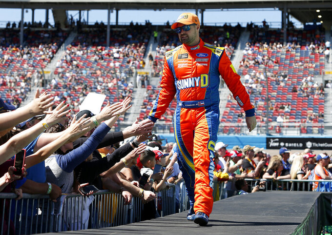 Ricky Stenhouse Jr. is greeted by fans during driver introductions prior to the start of the NASCAR Cup Series auto race at ISM Raceway, Sunday, March 10, 2019, in Avondale, Ariz. (AP Photo/Ralph Freso)