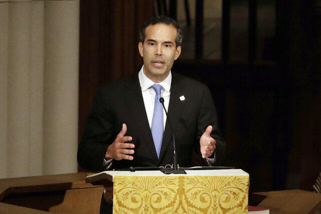 FILE - In this Dec. 6, 2018 file photo, George P. Bush pauses as he gives a eulogy during a funeral for former President George H.W. Bush at St. Martin's Episcopal Church, in Houston. Bush condemned racism in his party Thursday, Dec. 12, 2019 over what he says is now a third instance in Texas this month of