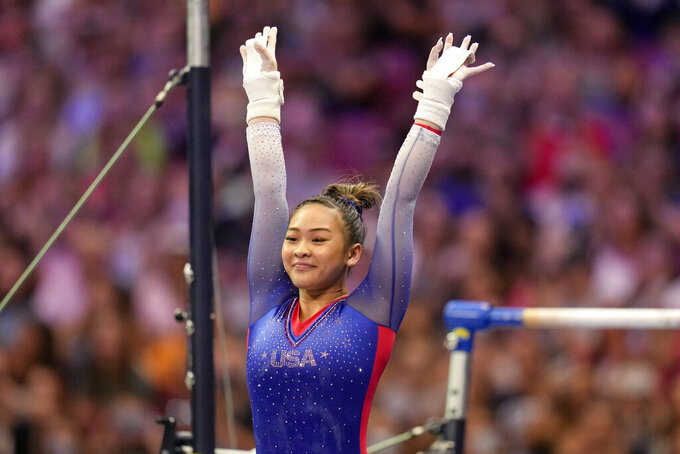 """FILE - Suni Lee reacts to her performance on the uneven bars during the women's U.S. Olympic Gymnastics Trials on June 25, 2021, in St. Louis. Lee also is joining the cast will join the cast of """"Dancing With The Stars"""" for the show's upcoming 30th season. (AP Photo/Jeff Roberson, File)"""