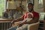 """This image released by Netflix shows Kevin Hart in a scene from """"Fatherhood."""" (Philippe Bosse/Netflix via AP)"""