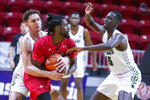 Chicago State forward Amir Gholizadeh, left, and center Noah Bigirumwami, right, wrap up Jacksonville State guard Ty Hudson for a jump ball in the first half of an NCAA college basketball game at the Emerald Coast Classic in Niceville, Fla., Friday, Nov. 29, 2019. (AP Photo/Mark Wallheiser)