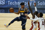Denver Nuggets guard Gary Harris (14) looks to pass the ball as Miami Heat center Bam Adebayo (13) and guard Kendrick Nunn (25) defend and during the first half of an NBA basketball game, Wednesday, Jan. 27, 2021, in Miami. (AP Photo/Marta Lavandier)