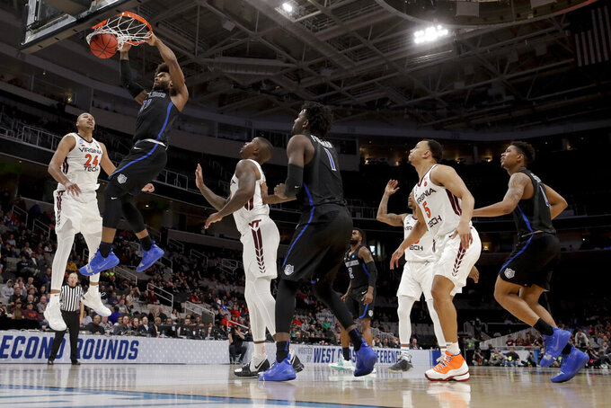 Saint Louis forward Hasahn French (11) dunks over Virginia Tech forward Kerry Blackshear Jr., left, during the second half of a first-round game in the NCAA men's college basketball tournament Friday, March 22, 2019, in San Jose, Calif. (AP Photo/Jeff Chiu)