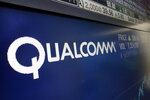 FILE - This Wednesday, Feb. 14, 2018 file photo shows the logo for Qualcomm on a screen at the Nasdaq MarketSite, in New York. The European Union has fined U.S. chipmaker Qualcomm $271 million, accusing it of