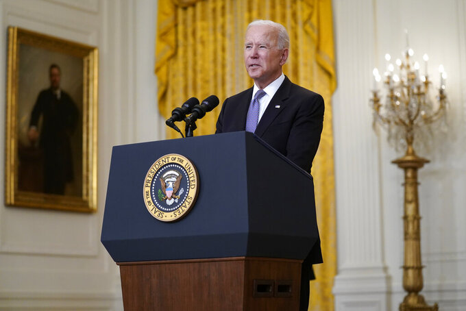 FILE President Joe Biden speaks about distribution of COVID-19 vaccines, in the East Room of the White House, Monday, May 17, 2021, in Washington.  The Biden administration announced Tuesday, May 18 it would repeal the changes made by the Trump administration to an important law made to stop banks from discriminating against racial minorities and the poor. (AP Photo/Evan Vucci)