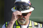 Jim Southworth, National Transportation Safety Board Investigator-in-Charge, adjusts his hardhat during a news conference, Monday, Sept. 27, 2021, in Chester, Mont., near the scene where an Amtrak train derailed Saturday, killing three people and injuring others. (AP Photo/Ted S. Warren)