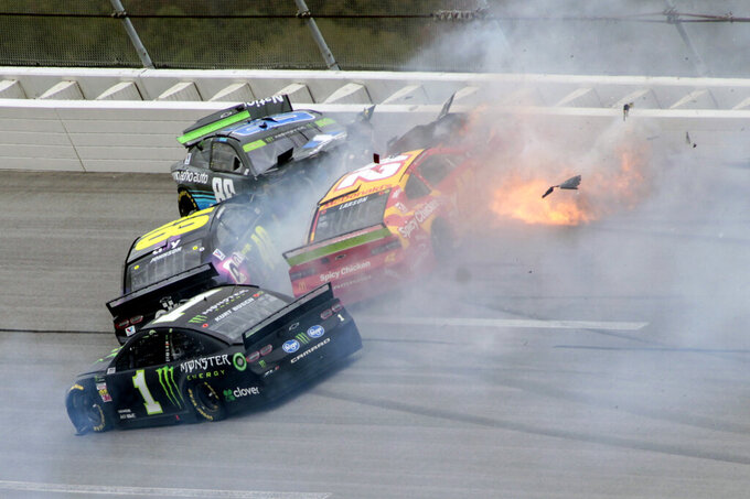 Kurt Busch (1), Jimmie Johnson (48), Alex Bowman (88) and Kyle Larson (42) collide in Turn 3 during a NASCAR Cup Series auto race at Talladega Superspeedway, Monday, Oct 14, 2019, in Talladega, Ala. (AP Photo/Greg McWilliams)
