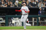 Boston Red Sox's Travis Shaw celebrates his three-run home run in the third inning of a baseball game against the Chicago White Sox, Saturday, Sept. 11, 2021, in Chicago. (AP Photo/Jeff Haynes)