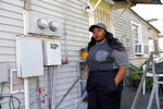 Tanya Harrell poses for a photograph in her McDonalds work uniform before her shift, outside her home in Gretna, La., Wednesday, Sept. 12, 2018. Harrell, 22, filed a complaint with the EEOC in May alleging that her two managers at a local McDonald's teased her, but otherwise took no action after she told them of sustained verbal and physical harassment by a co-worker. Harrell, who makes $8.15 an hour, said she and many of her colleagues were skeptical of the company's commitment to combating harassment. (AP Photo/Gerald Herbert)