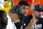 Pittsburgh Steelers quarterback Mason Rudolph, center, sits with offensive coordinator Randy Fichtner during the second half of an NFL football game against the Cincinnati Bengals in Pittsburgh, Monday, Sept. 30, 2019. (AP Photo/Tom Puskar)
