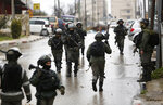 FILE - In this Wednesday, Jan. 9, 2019 file photo, Israeli forces deploy during a raid in the West Bank City of Ramallah. Israel has been launching raids into the heart of Ramallah, and the U.S. is cutting off aid and taking actions that many fear will obliterate any remaining hope for a two-state solution. (AP Photo/Majdi Mohammed, File)