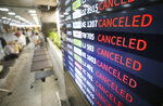 An electronic signboard shows canceled flights at Jeju Airport on Jeju Island, South Korea, Wednesday, Sept. 2, 2020. An offshore typhoon brought torrents of rain to southern Japan on Wednesday heading to the Korean Peninsula. (Byun Ji-chul/Yonhap via AP)