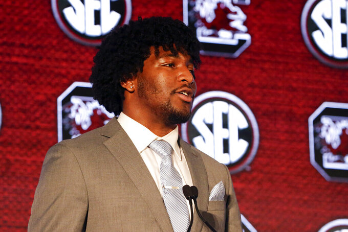 """FILE - South Carolina's Kingsley Enagbare speaks to reporters during the NCAA college football Southeastern Conference Media Days in hoover, Ala., in this Monday, July 19, 2021, file photo. First-year South Carolina coach Shane Beamer believes is new team is closer to the dominance it showed a decade ago than the way it performed the past couple of seasons. """"Everyday he's bringing high energy,"""" Enagbare said. """"Just the way he speaks, he speaks confidence and positive affirmation. That's definitely been important to the transition."""" (AP Photo/Butch Dill, File)"""