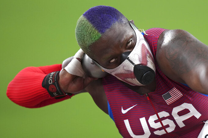 Raven Saunders, of the United States, competes in the qualification rounds of the women's shot put at the 2020 Summer Olympics, Friday, July 30, 2021, in Tokyo. (AP Photo/Matthias Schrader)