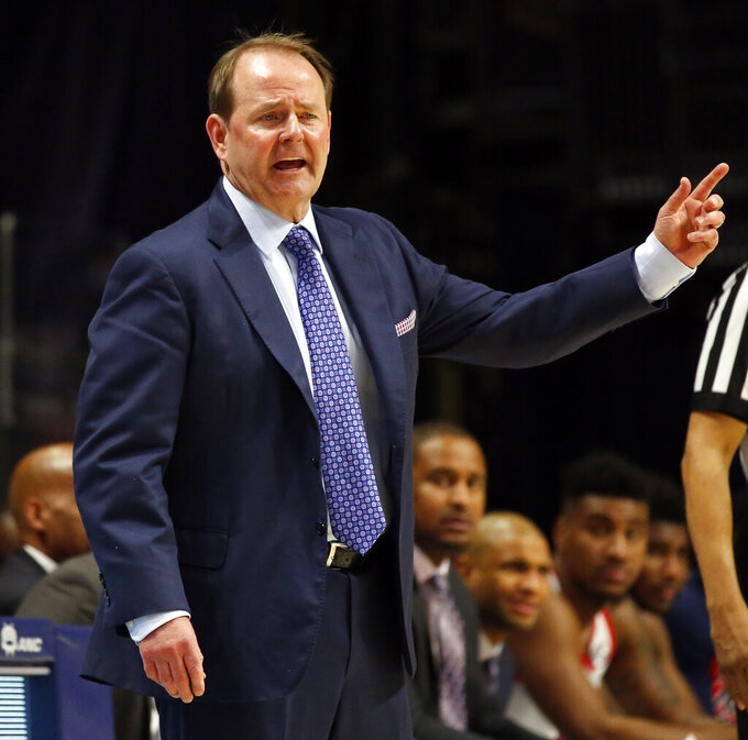 Mississippi head coach Kermit Davis directs his team during the second half of an NCAA college basketball game against Arkansas in Oxford, Miss., Saturday, Jan. 19, 2019. Mississippi won 84-67. (AP Photo/Rogelio V. Solis)