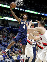 New Orleans Pelicans guard Elfrid Payton (4) scores against the Portland Trail Blazers in the first half of an NBA basketball game in New Orleans, Friday, March 15, 2019. (AP Photo/Scott Threlkeld)