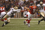FILE - In this Sept. 25, 2006, file photo, New Orleans Saints' Steve Gleason blocks a punt which the Saints ran in for the first score of an NFL football game against the Atlanta Falcons, at the Louisiana Superdome in New Orleans.  (Michael DeMocker/The Times-Picayune/The New Orleans Advocate via AP, File)