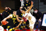 Rutgers guard Geo Baker (0) defends against Iowa guard CJ Fredrick (5) during the second half of an NCAA college basketball game in Piscataway, N.J., Saturday, Jan. 2, 2021. (AP Photo/Noah K. Murray)