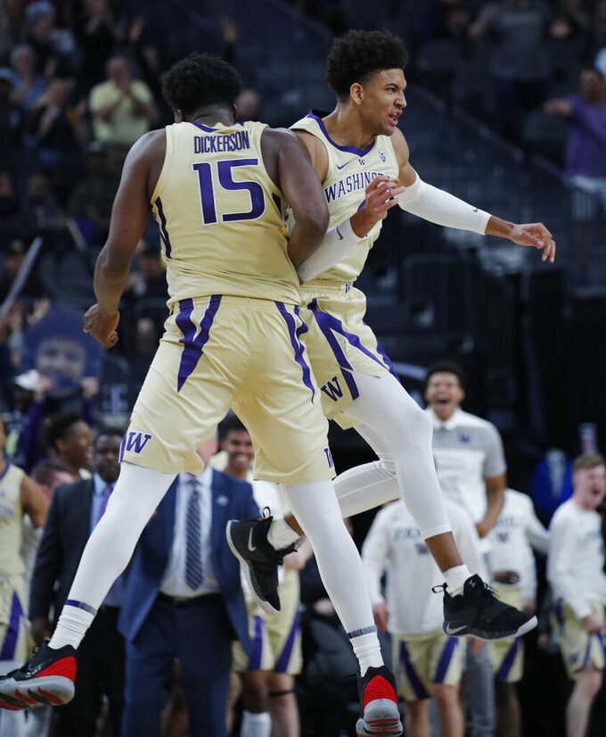 Washington's Noah Dickerson (15) and Matisse Thybulle celebrate after a play against Southern California during the second half of an NCAA college basketball game in the quarterfinal round of the Pac-12 men's tournament Thursday, March 14, 2019, in Las Vegas. (AP Photo/John Locher)