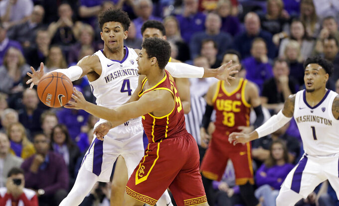 Washington's Matisse Thybulle (4) defends against Southern California's Derryck Thornton during the first half of an NCAA college basketball game Wednesday, Jan. 30, 2019, in Seattle. (AP Photo/Elaine Thompson)